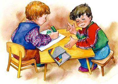 Группа детей  играют в развивающие игры